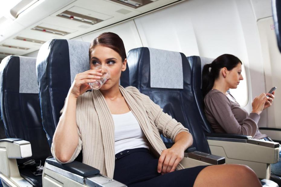 The One Thing You Should Never Drink On A Plane photo