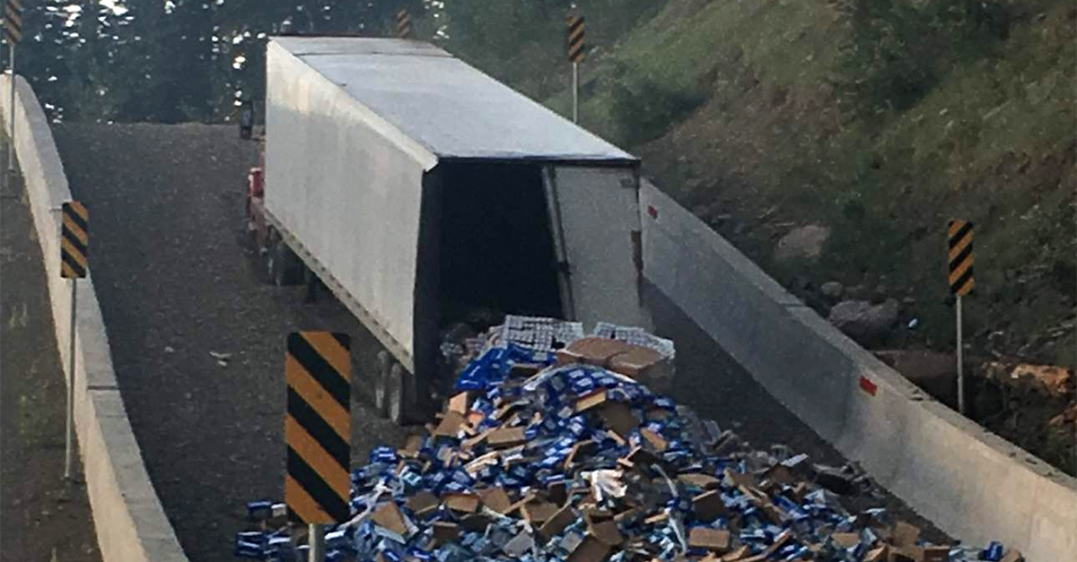 Truck Dumps 42,100 Pounds Of Bud Light On Highway photo