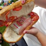Woman caught with bottle of vodka inside a giant sandwich at event photo