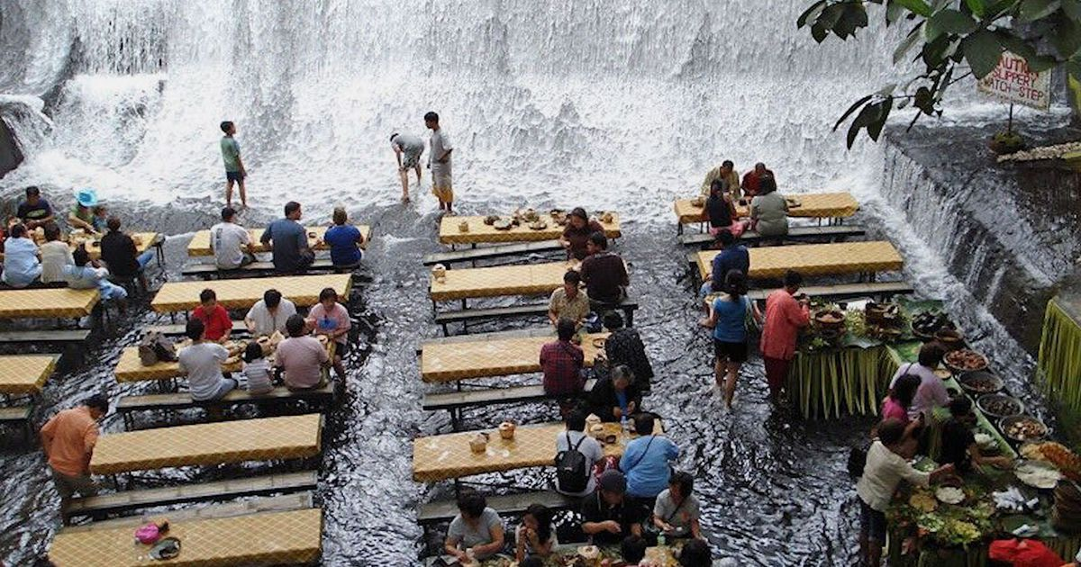 Get wet and wild at this restaurant that is literally situated in a waterfall photo