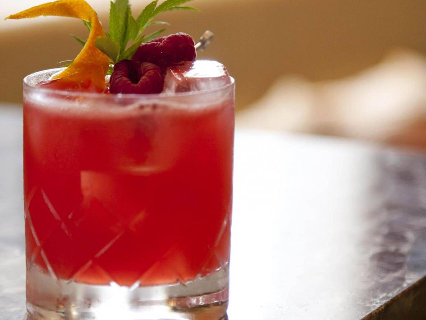 How To Make A Rosemary, Lemon, Apple And Cranberry Mocktail photo