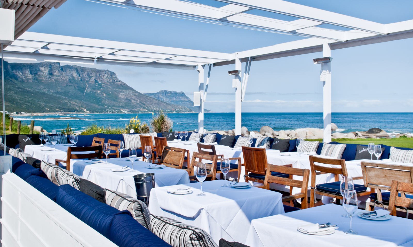 Sea Views, Sunsets, And Sand: The Best Beach Bars In Cape Town photo