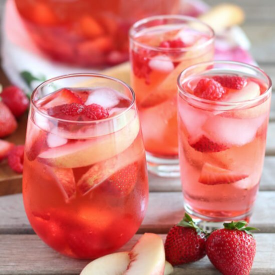 2368489 peach rose sangria Sip your way to romantic bliss with these pink drinks recipes