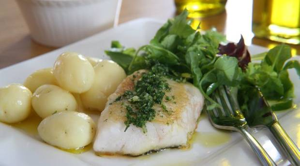 Chunky whitefish with garlic, lemon and olive oil photo
