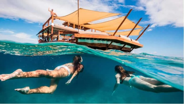 A Floating Pizza Bar In The Middle Of The South Pacific photo