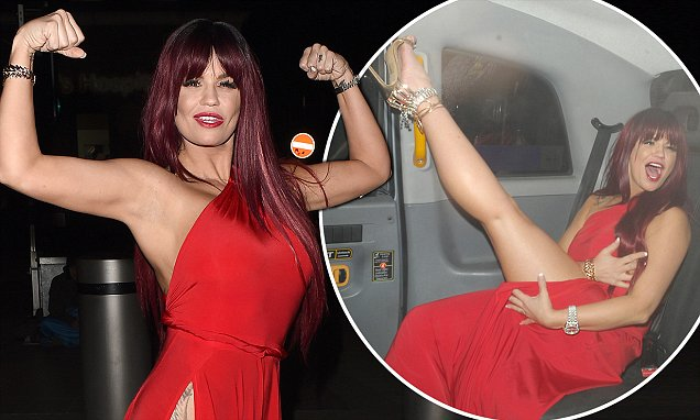 Underwear-free Kerry Katona Wears Russet Wig And Very Racy Red Dress photo