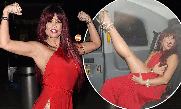 Underwear-free Kerry Katona Wears Russet Wig And Very Racy Red Dress photo