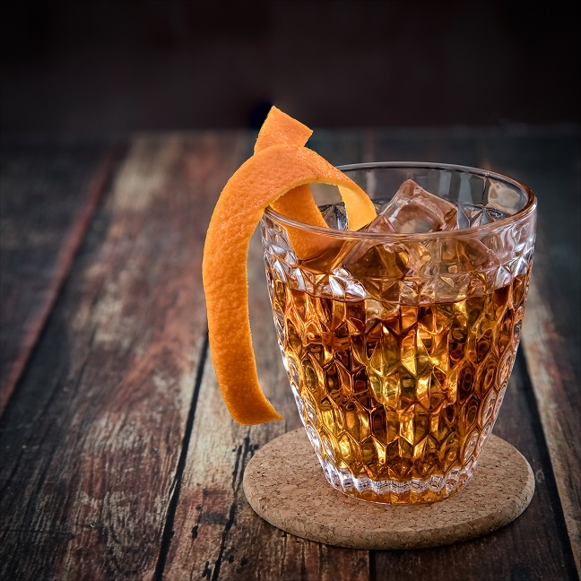 An Old Fashioned Cocktail With A Citrus Twist photo
