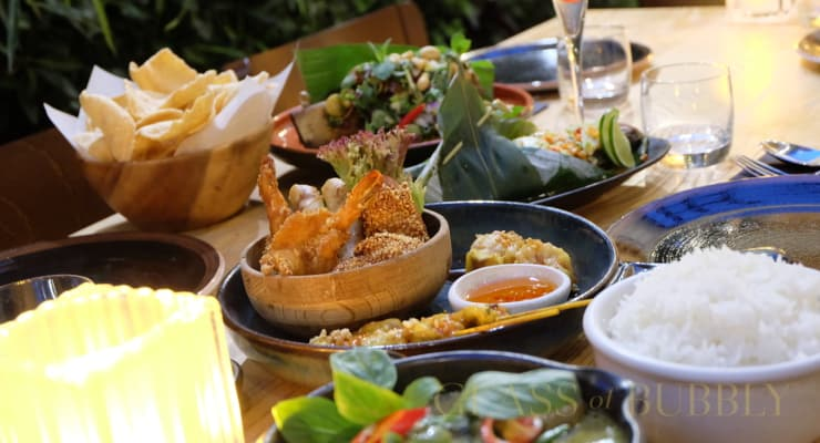 A Glass Of Champagne And Thai Cuisine photo