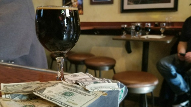 This Beer Was Brewed With Pizza And Money photo