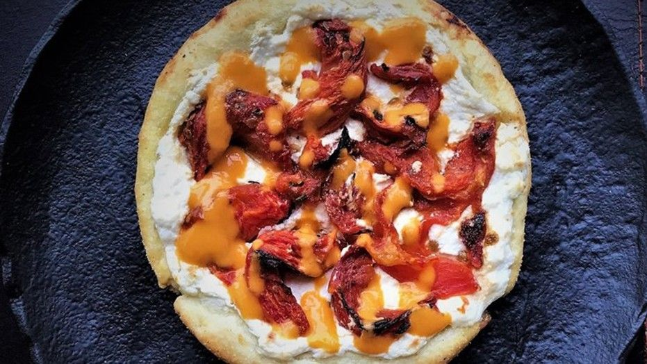 Restaurant launches vodka-infused pizza photo