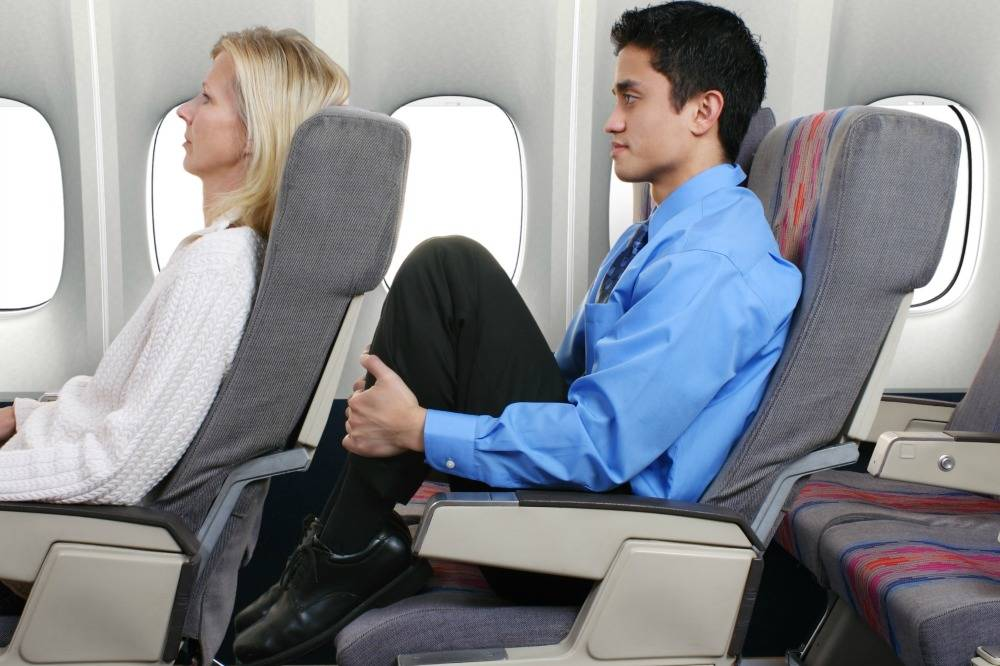 To Recline, Or Not To Recline: The Great Plane Seat Debate photo