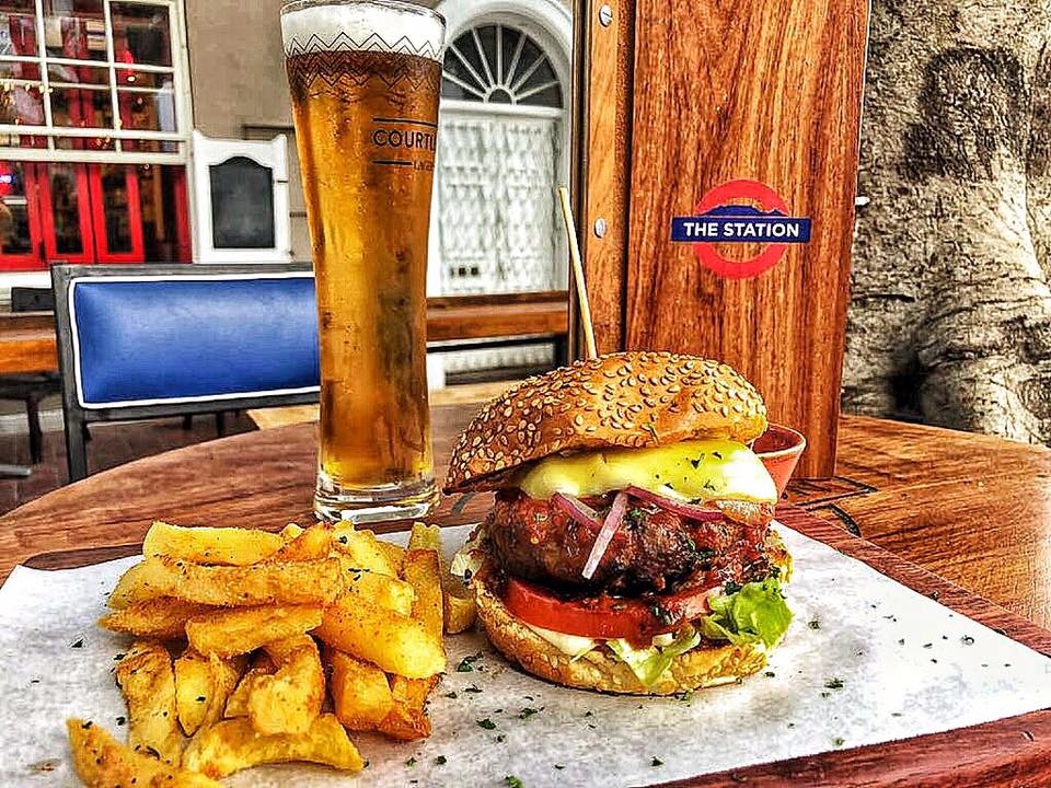 Burger, fries and draught photo