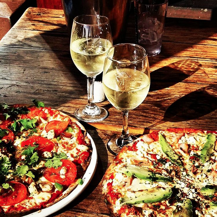 Two large pizzas and a bottle of wine for only R220 photo