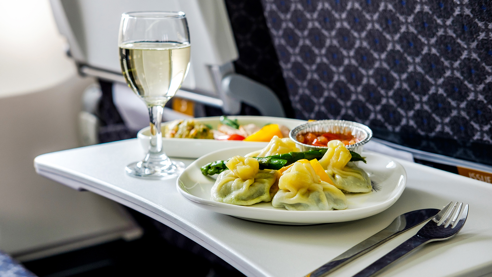 Wines On A Plane: Does Drinking Affect You Differently While Flying? photo