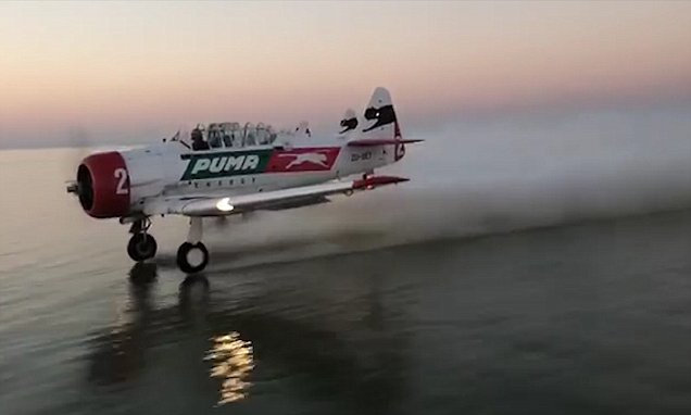 Breathtaking Moment Daredevil Pilots Land On Lake In South Africa photo