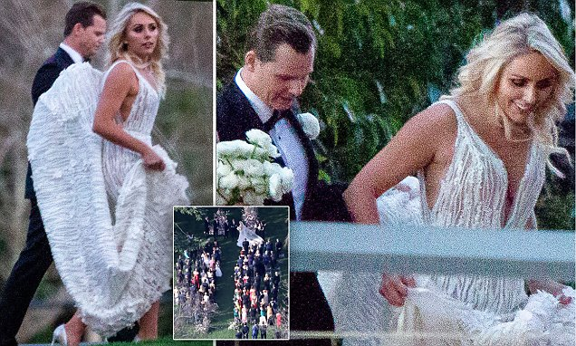Steve Smith Holds The Skirt Of His Bride Dani Willis' Wedding Gown photo