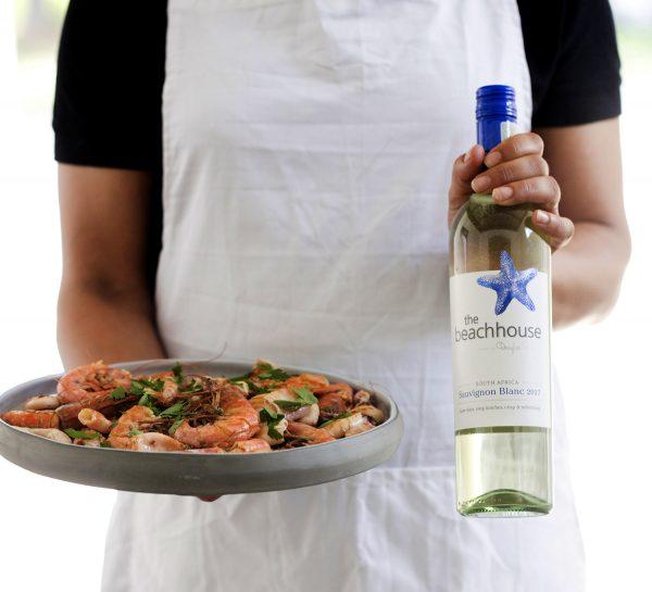 A glass of the Beachhouse Rosé makes this paella perfect photo