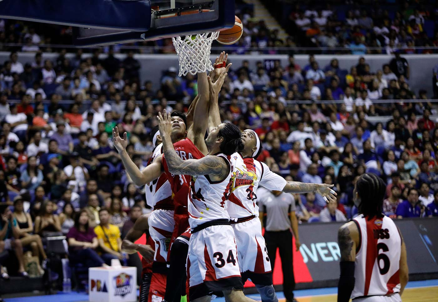 Ginebra Trips San Miguel In Heated Rematch photo