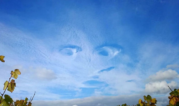 Head In The Clouds! Spooky Moment A Shocked Face Appears In Sky photo
