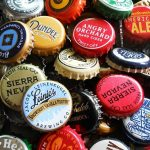Why don't all beer bottles have screw caps? photo