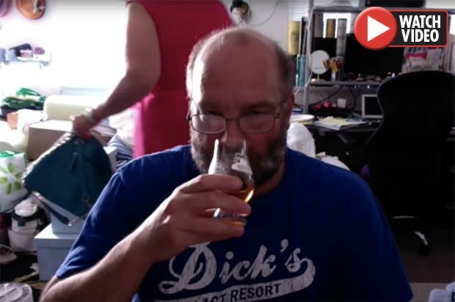 Whisky Fan Reviews Scotch While His Wife Packs Her Bags And Leaves Him In The Background photo