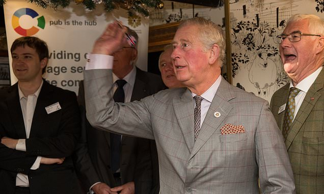 Charles Takes A Tipple And Grabs The Arrows In Pub Visit photo