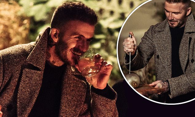David Beckham Raises A Glass Before Tucking Into Haggis photo