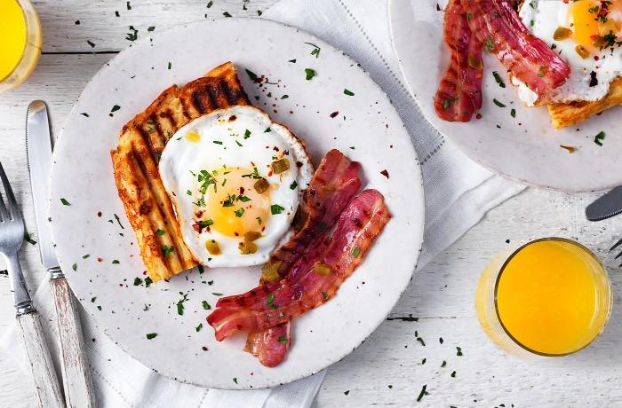 2 Eggs, Bacon, Tomato and Potato Rosti Breakfast photo