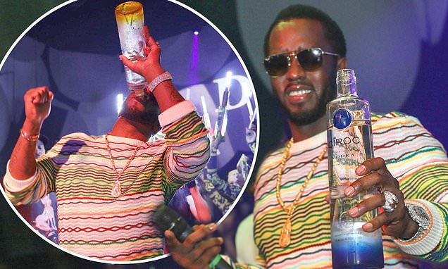 Diddy Downs A Bottle Of Vodka As He Parties With Pal Jermaine Dupri photo