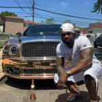 50 Cent Washes Bentley Wheels With Champagne photo