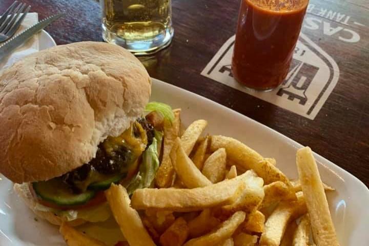 Burger, chips and half a pint of beer photo