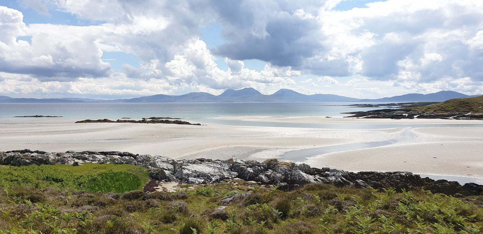 One Of Scotland's Most Beautiful Islands With Stunning White Sand Beaches Now Offers A Gin Retreat With Over 200 Gins photo