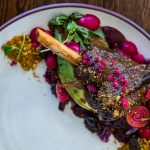 Venison shanks with baby beets, chestnuts and blueberries photo
