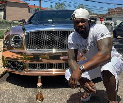 Watch: 50 Cent Cleans His Bentley Tyres With Champagne photo