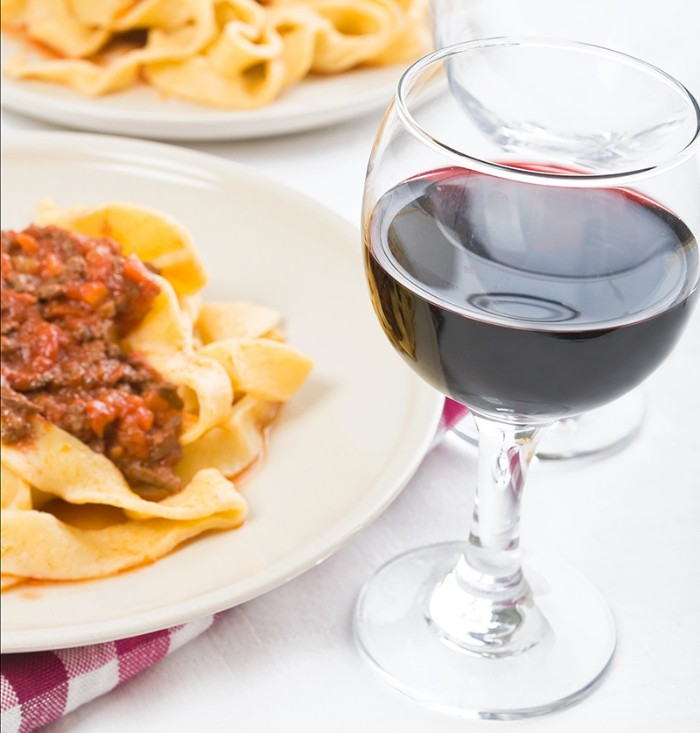 Pasta and glass of wine photo