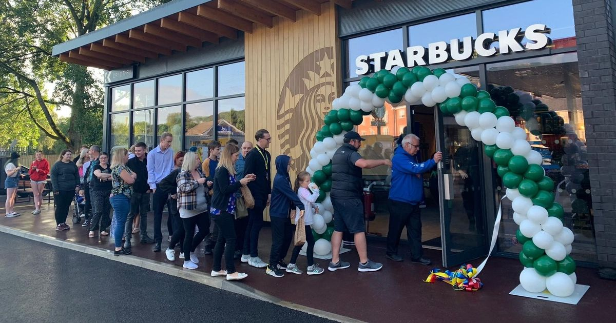 Customers Queue Outside As Starbucks Opens First Store In The Area photo
