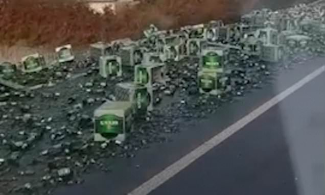 Trail Of 'devastation' As A Lorry Spills Its Load Of Becks Beer photo