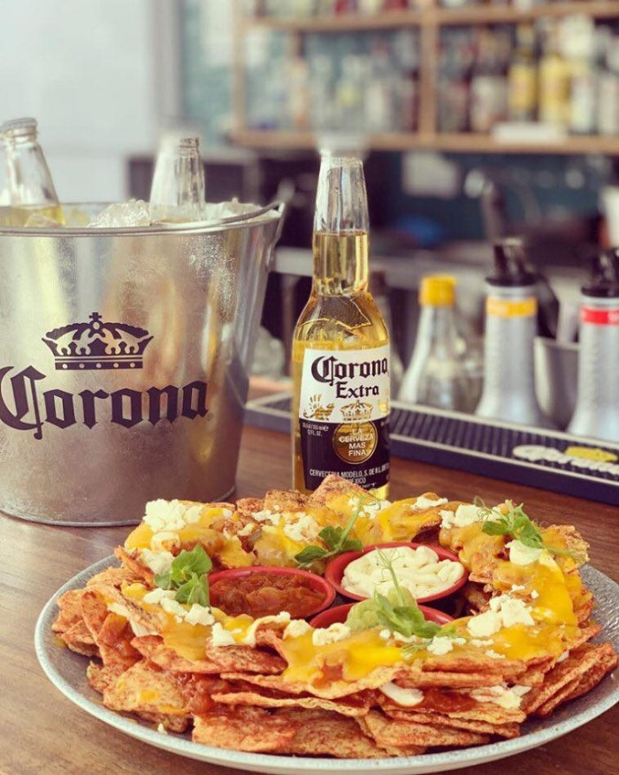 Free nachos with every bucket of beer photo