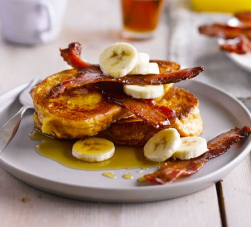 Brioche French toast with bacon, banana and maple syrup photo