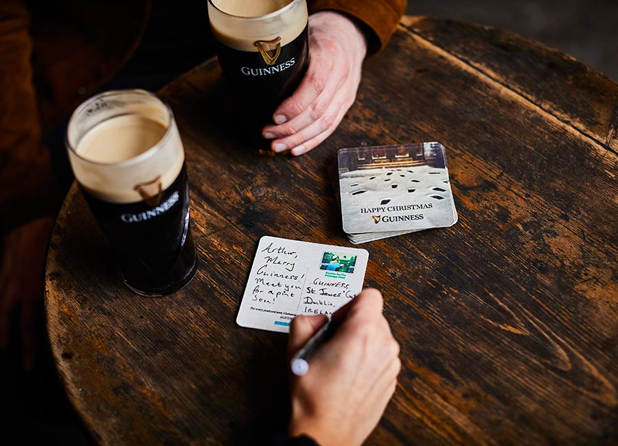 Guinness Are Giving Drinkers Beer Mats That Double As Postcards To Be Sent To Love Ones At Christmas photo