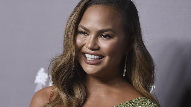 Chrissy Teigen Isn't Completely Sold On Her New Bangs photo