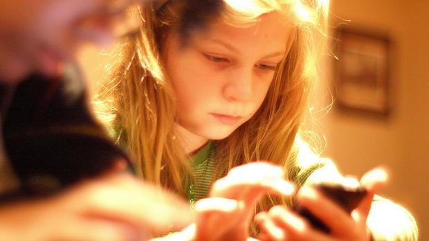 What Is The Right Age To Give A Child A Phone? photo