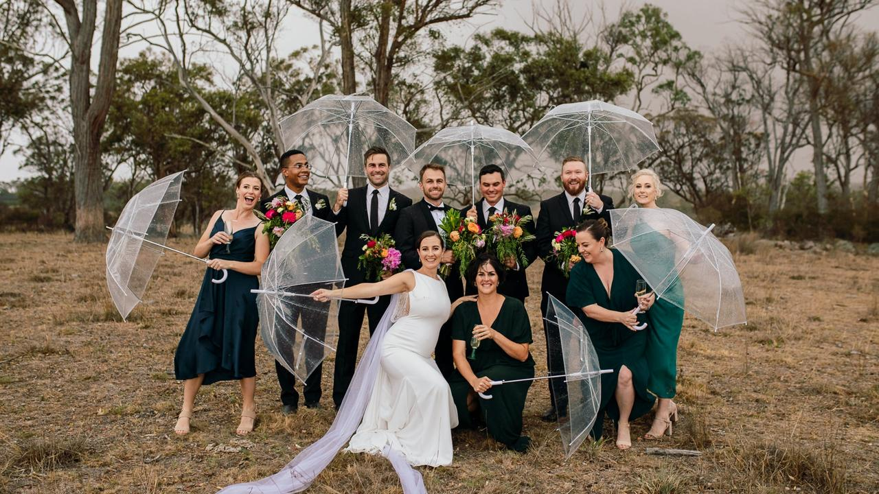 'wall Of Water': Couple Wed At Rain Soaked Wedding photo
