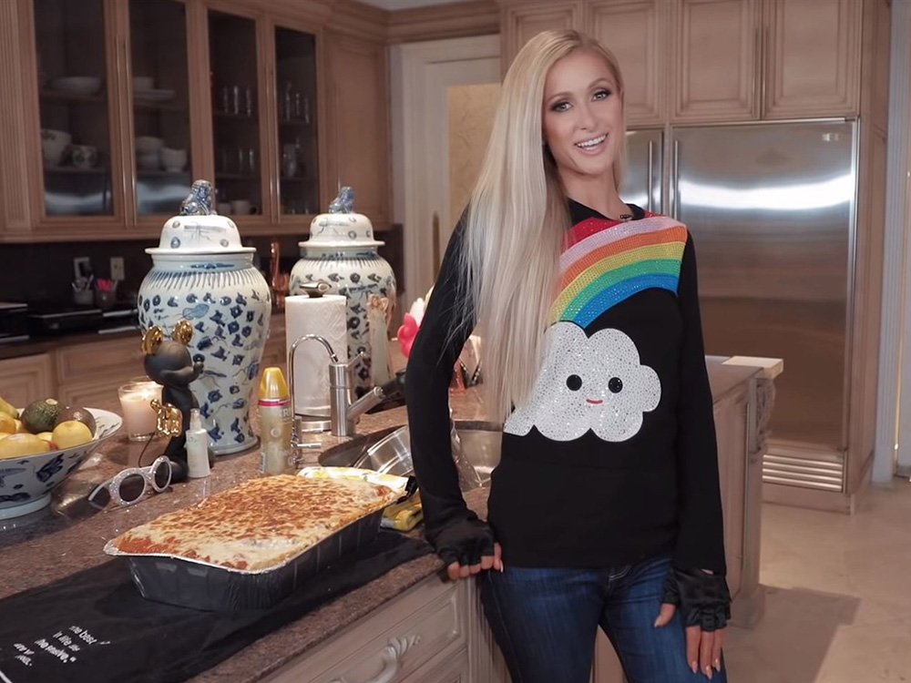 Paris Hilton Wears Sunglasses While Chopping Onions And Fingerless Gloves While Making Lasagna In New ?cooking Show? photo
