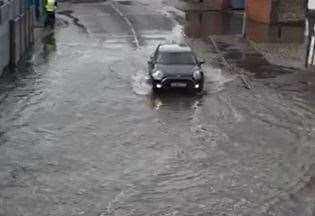 Flash Flood Leaves Cars Stranded photo