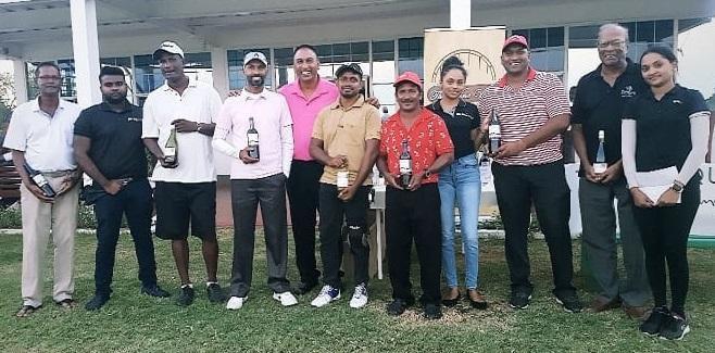 Dinnanauth, Harry, Solomon Win Wine Vault Golf Tourney photo