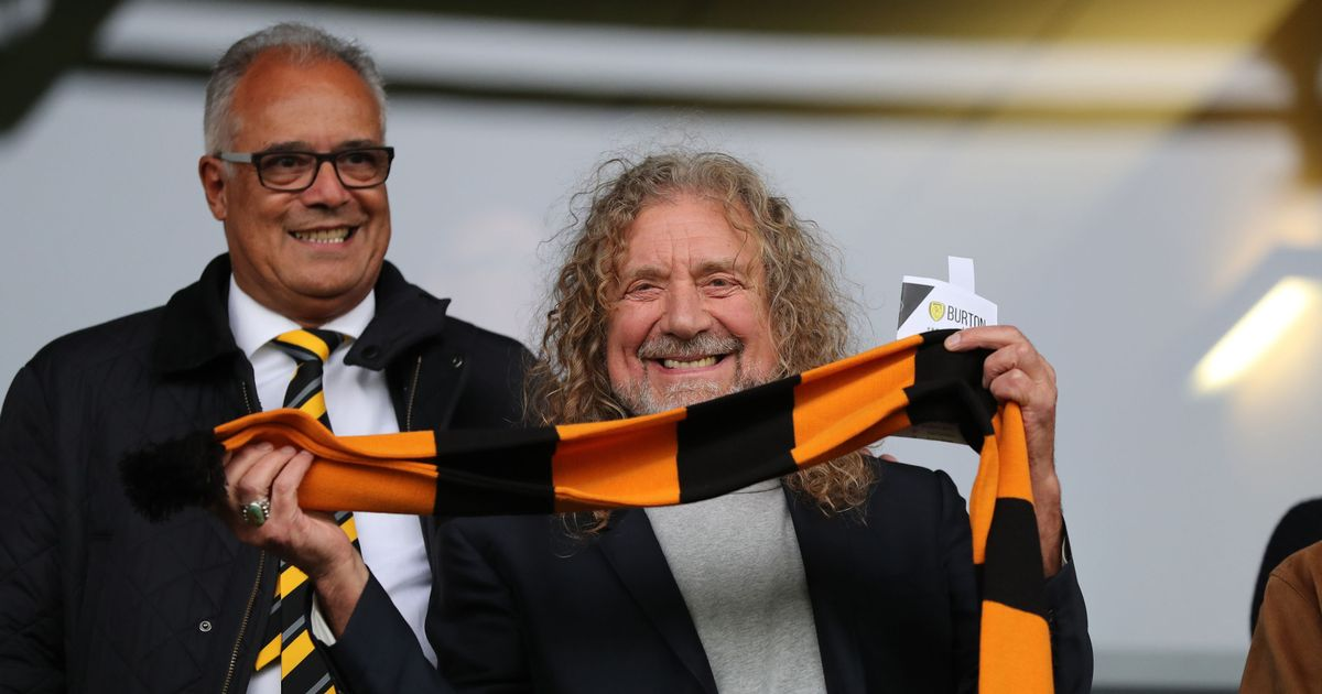 Rock Legend Robert Plant Drinks With Spurs Fans As He Watches Beloved Wolves photo
