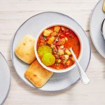 Make Your Own Hamburger Soup Topped With Pickles photo