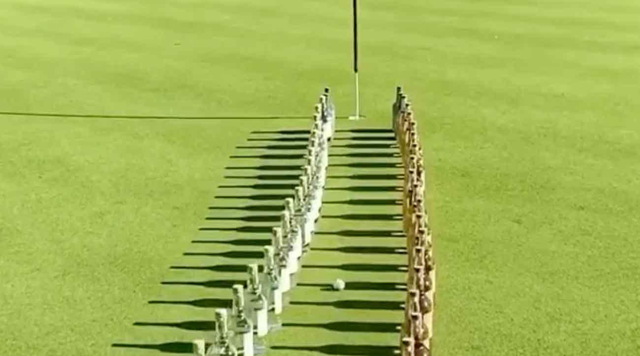 Golf Top 100 Teacher Mixes 100 Bottles Of Tequila With A 40-foot Putt photo